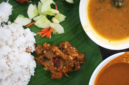 south india: Delicious Indian cuisine spicy banana leaf rice