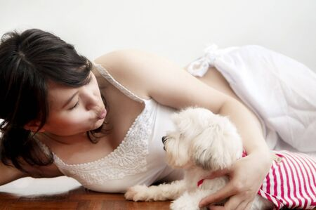 shih: Pregnancy Asian woman playing with her Shih Tzu dog. Stock Photo