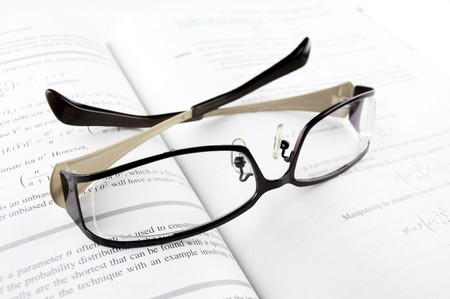 Pair of Glasses on the Mathematics Book Stock Photo - 7569590