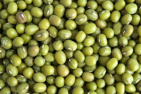 Whole dried mung beans. This type of bean is often sprouted to make bean sprouts. photo