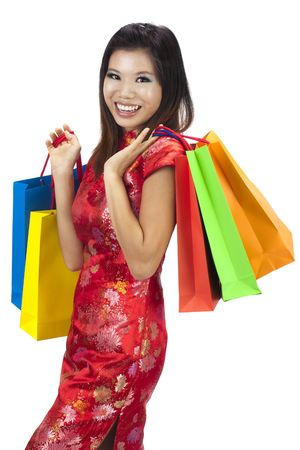 Woman in tradition Cheongsam holding colorful shopping bag. Stock Photo - 7628078