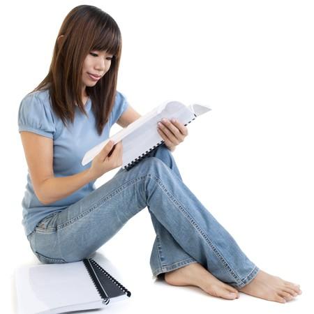 Asian student sitting on floor, reading on book. Stock Photo - 7720123