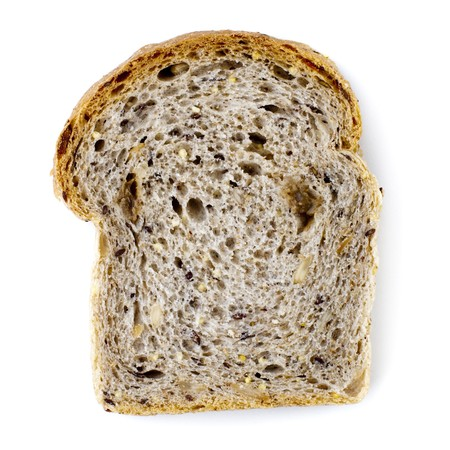 Single slice wholemeal bread isolated over white background photo