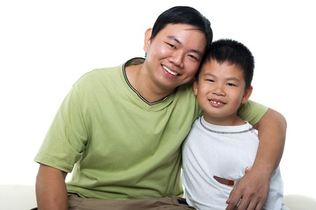 Asian father and son isolated on white photo
