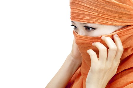 Close up picture of a Muslim woman wearing a orange veil photo
