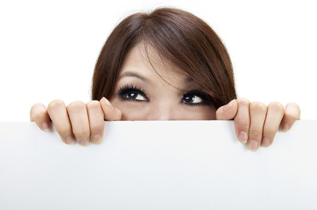 Woman holding and hiding behind billboard / blank sign. Isolated on white. Stock Photo - 7720199