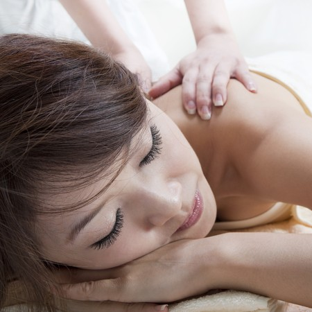 Beauty and Spa - Asian Girl having a massage on her back Stock Photo - 7720193