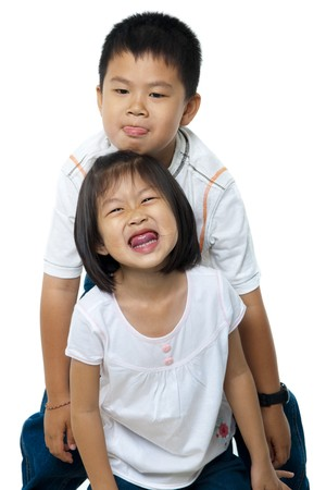 Asian brother and sister on white background photo