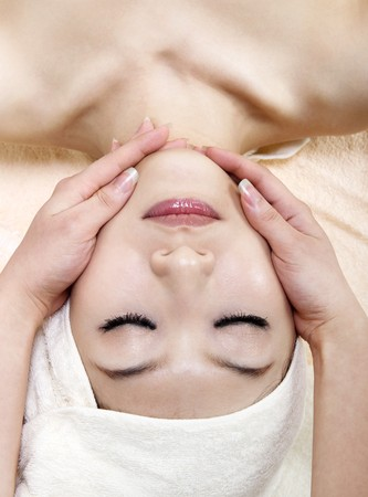 Beauty and Spa - Asian Girl having a massage on her face photo