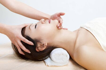 Beauty and Spa - Young Girl having a massage on her face Stock Photo - 7863436
