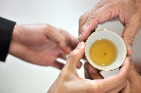 chinese tea: Chinese Tea ceremony is performed during a Chinese wedding or Chinese New Year.  Stock Photo