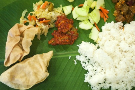 veg: Overhead view Indian cuisine banana leaf rice Stock Photo