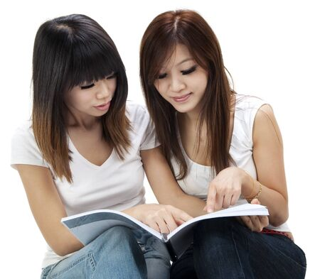 Asian students sitting learning together on white background photo