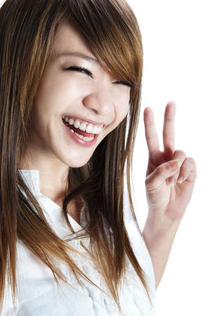 Cute asian young woman showing the peace  victory hand sign. photo