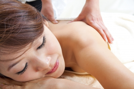 adult massage: Beauty and Spa - Asian Girl having a massage on her back Stock Photo