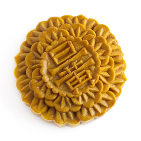 Chinese Mooncake isolated over white background, the Chinese words on the mooncake means yolk. photo