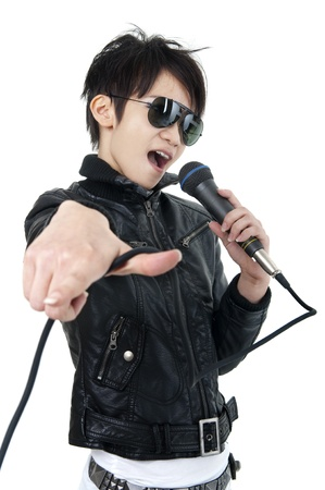 rockstar: Asian rock singer in performance, isolated on white Stock Photo