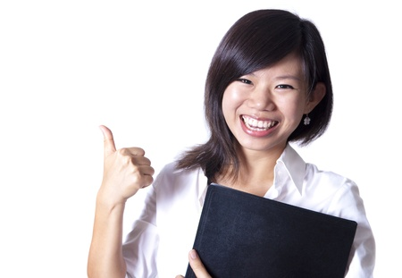 An Asian girl giving thumbs up sign and holding a file photo