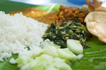 Indian cuisine banana leaf rice photo