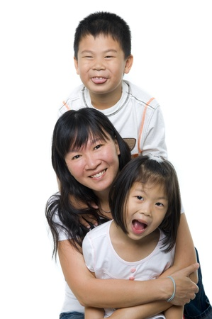 Asian mother and children on white background photo