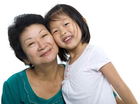 grandchild: Asian grandmother and grandchild on white background Stock Photo