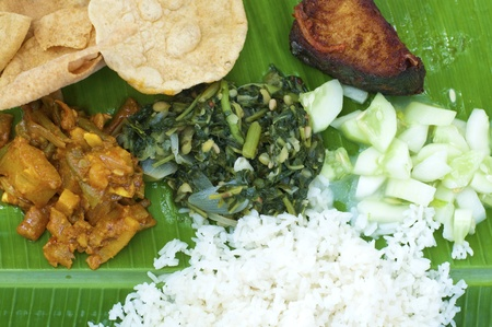 Close up Indian cuisine banana leaf rice photo