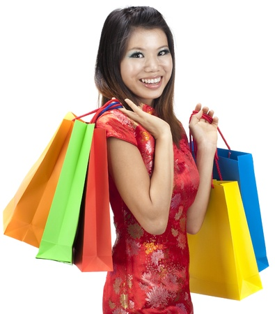 Oriental woman in red Traditional Chinese Cheongsam with shopping bag photo