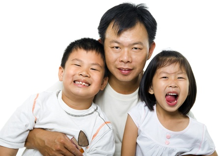 Asian father and children on white background photo