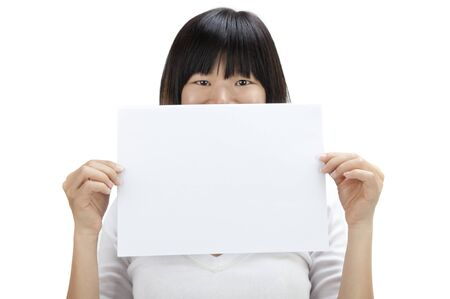 Concept of Asian woman holding a white card, covering her mouth. Stock Photo - 8569544