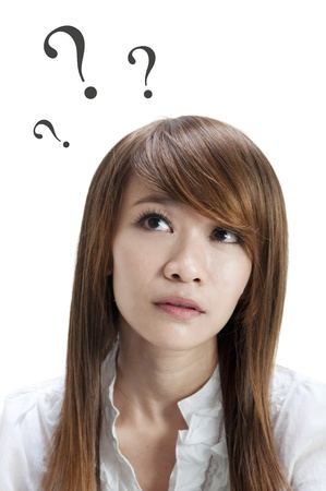 guessing: Wondering Asian girl on white background Stock Photo