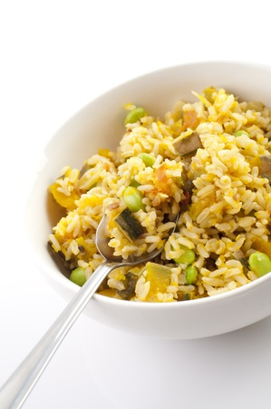 Bowl of pumpkin fried rice on white background photo