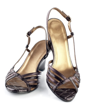 Pair of high heel brown female shoes isolated on white background photo