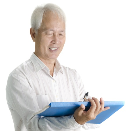 Asian senior businessman writing on document photo