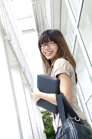 Young business businesswoman walking by an office building photo