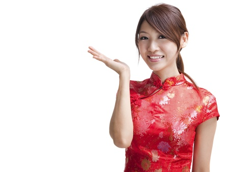 cheongsam: Asian Chinese woman in Traditional Chinese Cheongsam gesturing
