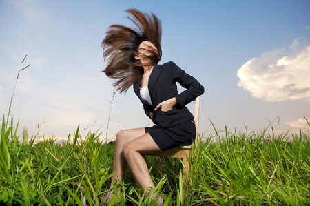 Outdoor Fashion businesswoman tossing her hair in air photo