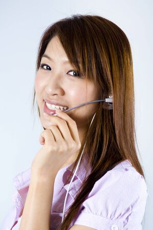 Friendly Customer Representative with headset smiling during a telephone conversation Stock Photo - 8910046