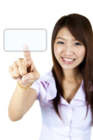 Young woman on white background is pressing on empty space photo