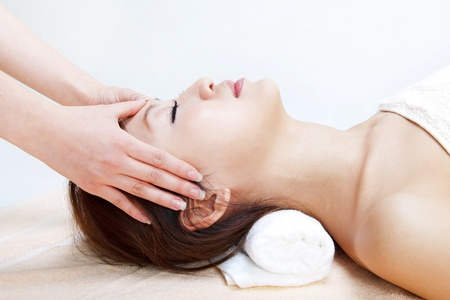 Beauty and Spa - Asian Girl having a massage on her head Stock Photo - 8910034