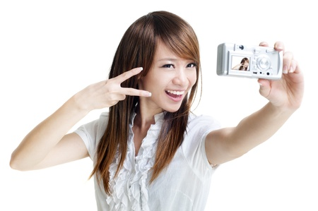 photo shooting: Asian girl self photographing, isolated on white Stock Photo