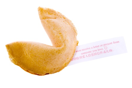 Isolated fortune cookie with a note. photo