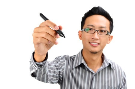 Closeup of young Asian businessman drawing on transparent glass or foil. photo