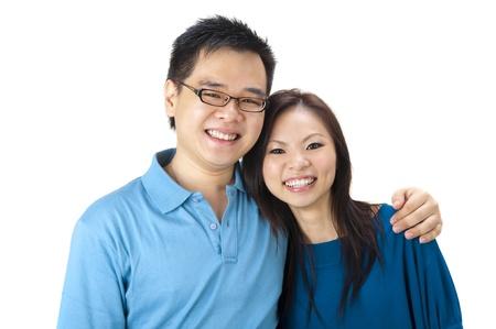asian wife: Beautiful Loving Couple on white background Stock Photo