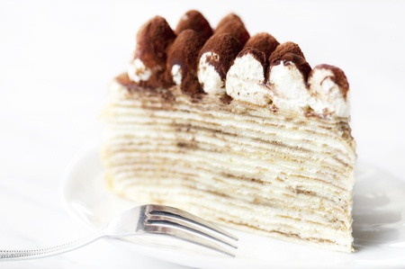 crepe: Portion of Tiramisu Mille crepe on a plate Stock Photo