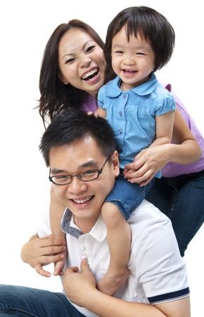happy asian family: Happy Asian family on white background Stock Photo