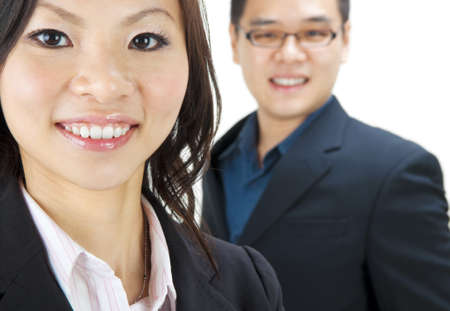 Asian business team, focus is on the woman. photo