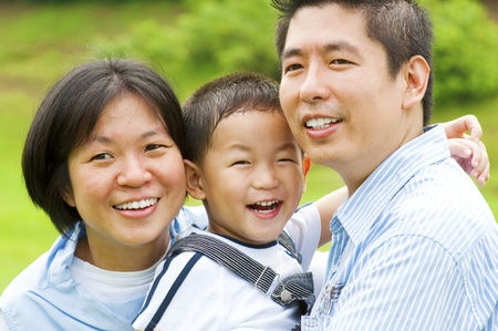candid: Happy Asian family at outdoors