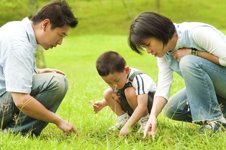 Candid Asian family at outdoors photo