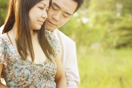 chinese garden: Loving Couple at outdoor during sunset