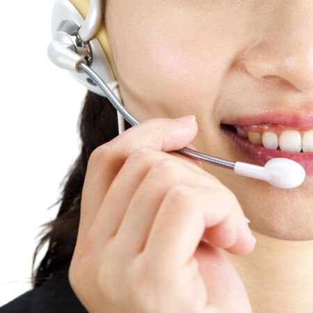 Friendly Customer Representative with headset smiling during a telephone conversation photo